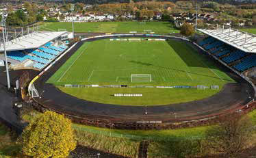a view of the Ballymena Showgrounds football field with the stands on either side