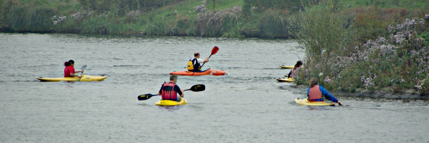 Photograph of people canoeing