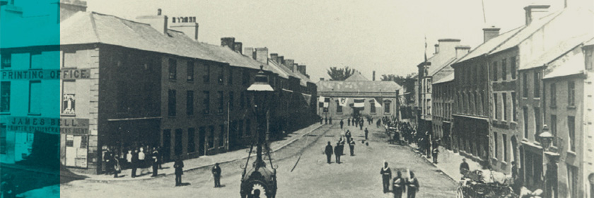 Image: an old photograph of Carrickfergus from the 1800s