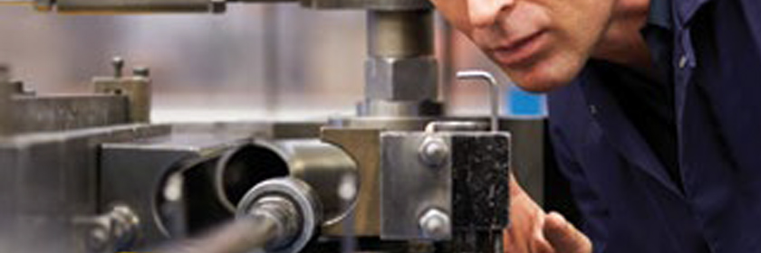 Photograph of someone using machinery