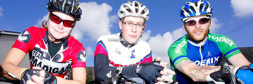Photograph of three cyclists