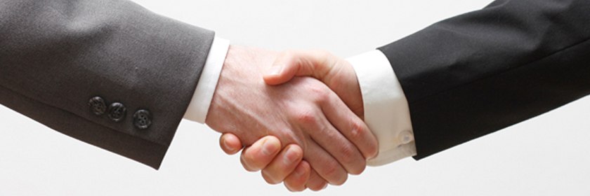 Photograph of two people shaking hands