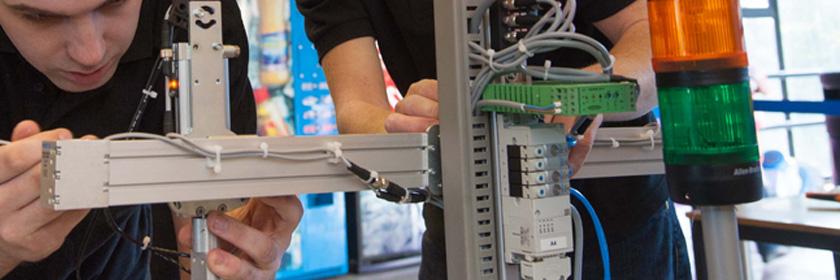 Photograph of a male working on some electronics.  Image Copyright : WorldSkills UK.