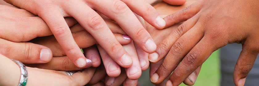 Image of hands from the Good Relations Week 2018 Flyer