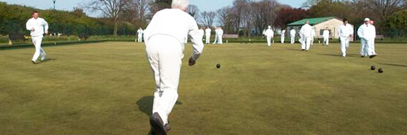 Photograph of a man playing lawn bowls
