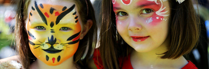 Photograph of two children with facepaints