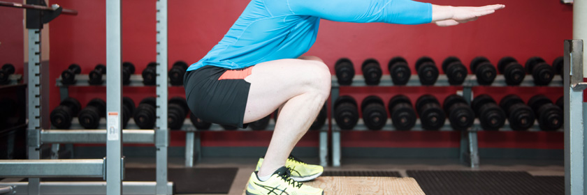 Photograph of someone doing a squat exercise