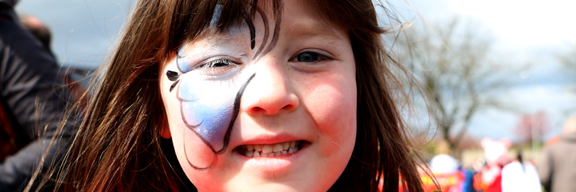 Photograph of child with her face painted