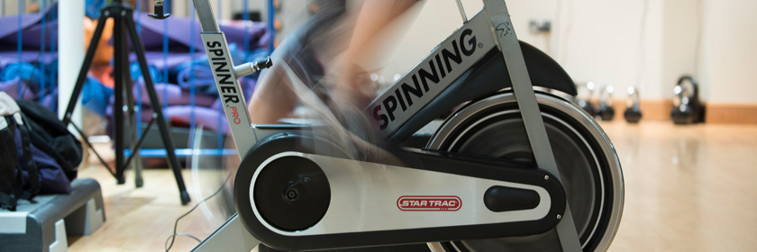 Photograph of someone on a spin bike