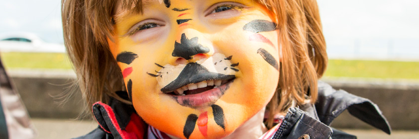 Photograph of a child with its face painted