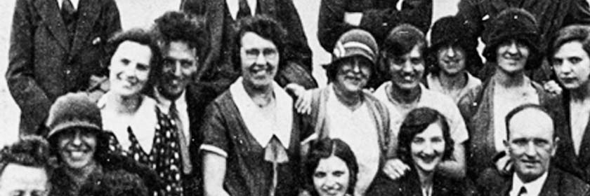 old black and white photo of a group of smiling people