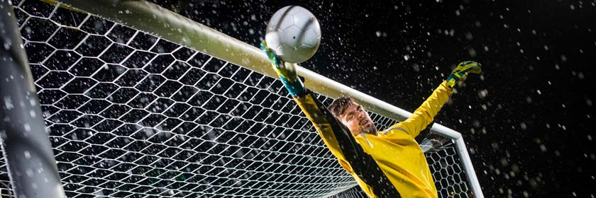 Photograph of a goal keeper diving