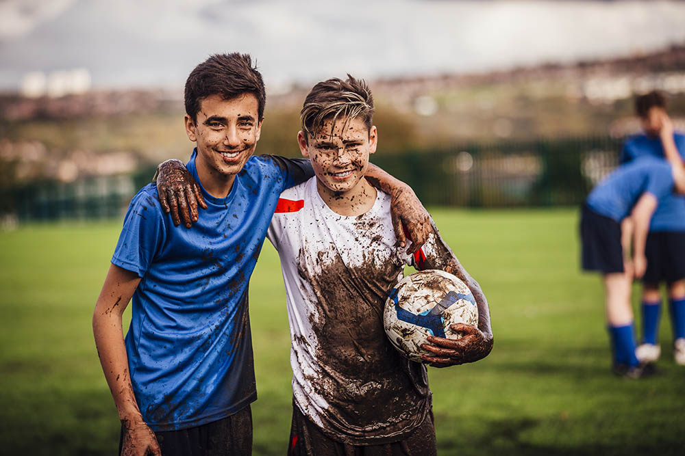 Stock image of two boys with a football