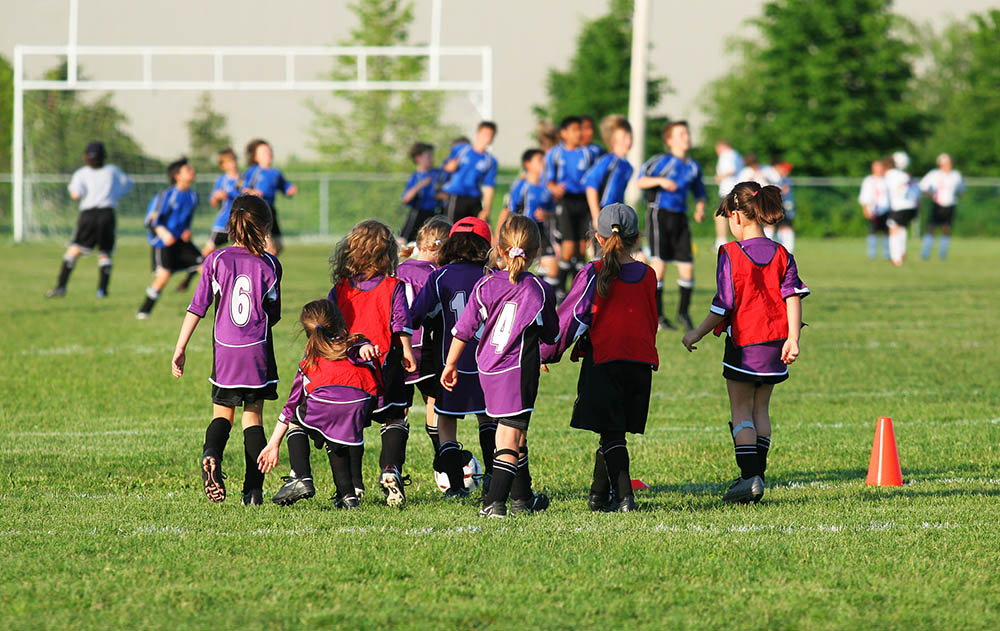 Stock image of children playing sports