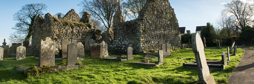 Photograph of an old church and graveyard