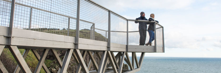 Photograph of two people at the top of The Gobbins walk