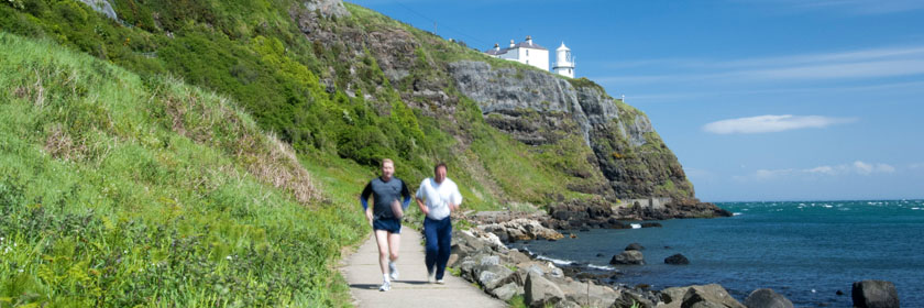 Image of two people jogging along Blackhead path