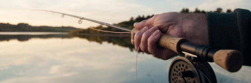 Photograph of someone fly-fishing