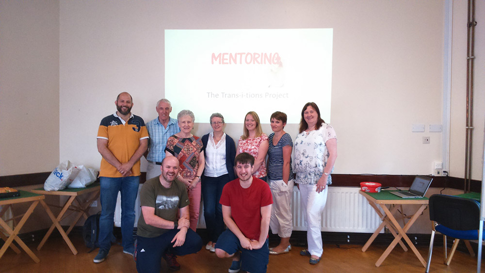 Chairperson of the MEA Peace IV Partnership, Ald Maureen Morrow is pictured with Paul Eaton, Trans-i-tions Support worker and a group of volunteer mentors who are undertaking an OCN level 2 in mentoring.