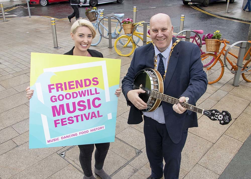 Mayor Paul Reid and Council Officer Sarah Davis promoting the Friends' Goodwill Music Festival 2018