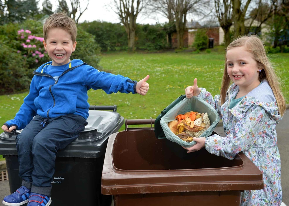 Food for thought! Food waste in focus: Oscar Millar (4) from Carrickfergus, gives the thumbs-up as Julia Pearson (7) also from Carrickfergus, demonstrates how to recycle – rather than 'bin' - food waste in Mid and East Antrim Borough.