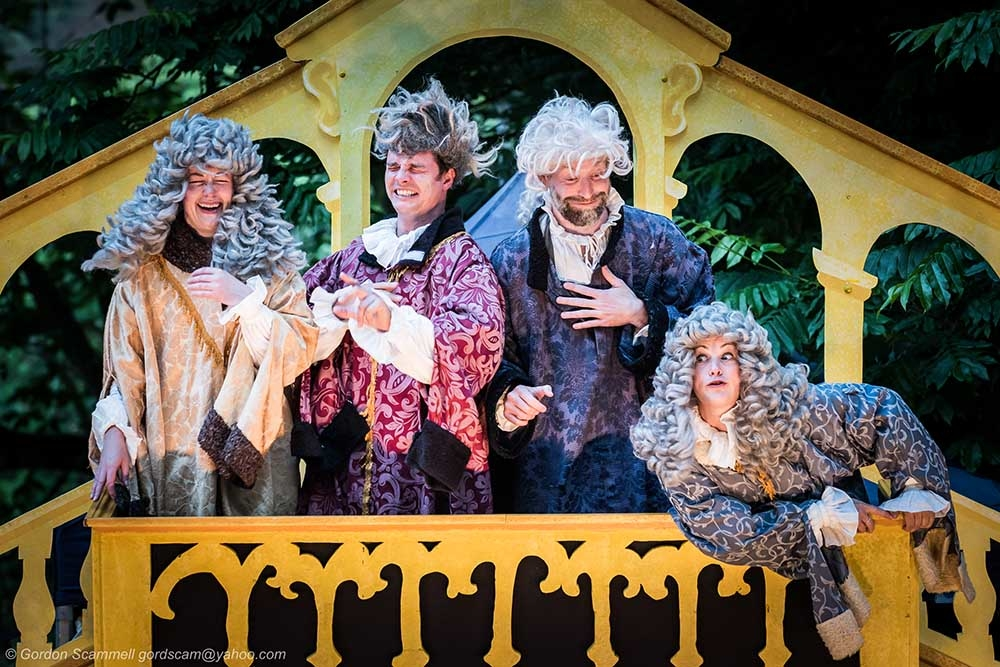 A performance of The Merchant of Venice by Illyria Theatre at Trebah Garden Amphitheatre in Cornwall.