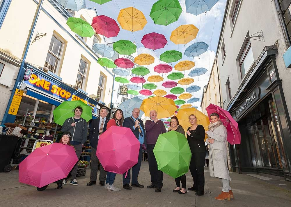 'Umbrella Street' is a new floating canopy of colourful brollies adding a splash of colour along West Street.
