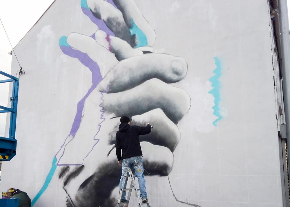 Eoin McGinn at work on the new street art in Ballymena.